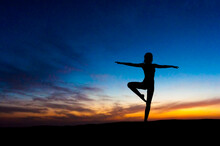 Silhouette Of Woman Dancing At...