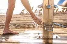Man Washing His Feet At The Be...