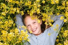Smiling Girl Lying In Rape Flowers