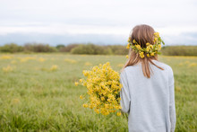Rear View Of Girl With Wreath And Rape Flowers