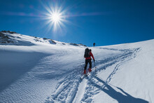 Senior Man Skiing On Snow Covered Dachstein Mountain Against Sky During Sunny Day, Austria