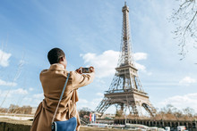 Woman Photographing Eiffel Tow...