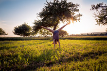 Teenage Girl Doing Handstand I...