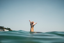 Womans Hand Making Surfer's Si...