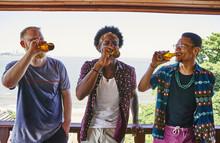 Multi-ethnic Male Friends Drin...