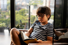 Portrait Of Boy Reading Book A...