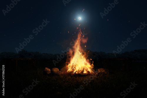 3d rendering of big bonfire with sparks and particles in front of forest and moo Fototapete