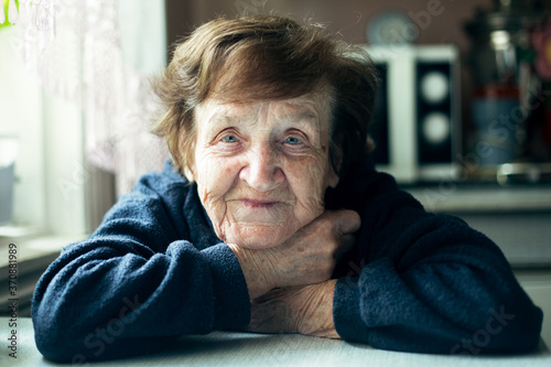 Fototapeta Close-up portrait of an Old woman in her home. obraz