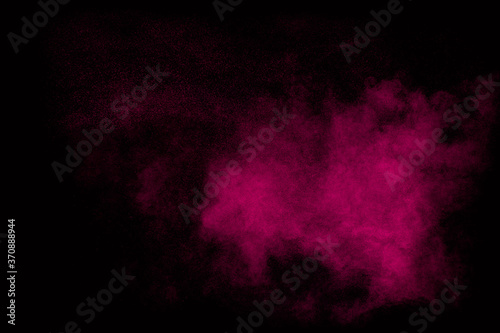 Cuadros en Lienzo Pink dust particles splash on black background