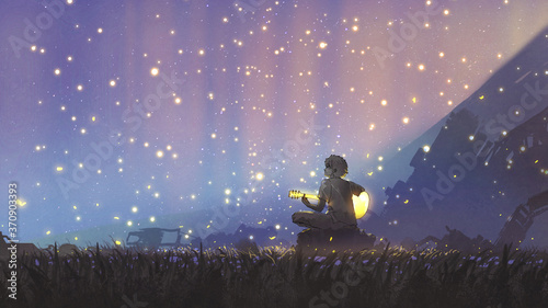 Photo a young boy plays guitar in the meadow and looking at the beautiful sky, digital