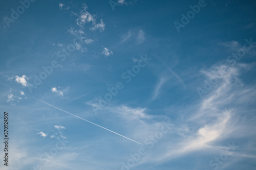 Fotografija Light wispy clouds in the deep blue sky