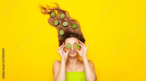 Girl with a kiwi fruit Fototapeta