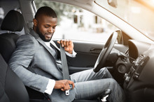 Handsome Black Businessman Fasten Seat Belt In His Car