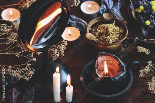 Candle flame divination in concave mirror on wiccan witch altar Fototapeta
