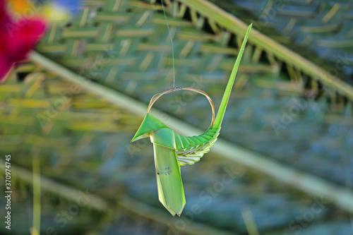 Valokuvatapetti Plam leaf bird decoration is hanging in wedding   hall entrance
