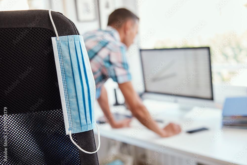 Fototapeta disposable face mask and man at work