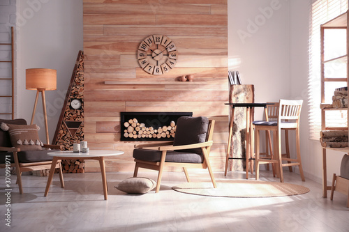 Fotomural Decorative fireplace with stacked wood in cozy living room interior