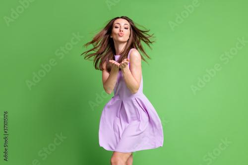 Stampa su Tela Photo of elegant energetic girl lady send air kiss two hands camera blowing hair