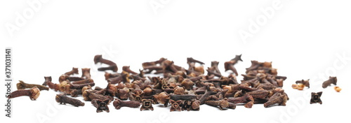 Leinwand Poster Dry cloves isolated on white background, top view