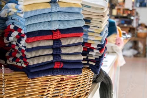 Cuadros en Lienzo pile of wool sweaters for sale