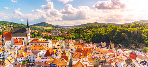 Fotografering Panoramic view of Cesky Krumlov with St Vitus church in the middle of historical city centre