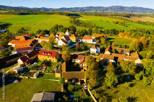 Fotografie, Obraz Autumnal aerial landscape of czech village Cakov with Church of Saint Leonard in