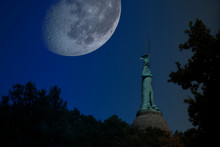 Composed Night Shot Of The Hermannsdenkmal With A Surreal Large Moon. Photomontage. Elements Of This Image Furnished By NASA