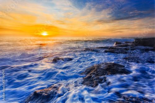Sea TB On rocks dawn foam Fototapet