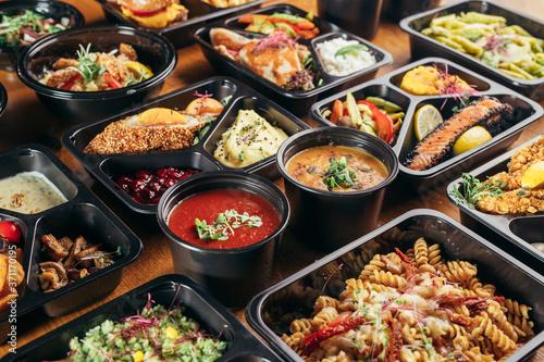 group of food in plastic dish on table. take away food Billede på lærred