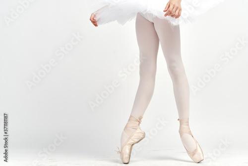 Obraz na plátně pointe shoes ballerina tutu dance child light background cropped view