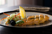A Piece Of Grilled Fish. Red F...