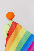 A Woman Wearing A Rainbow Top To Celebrate Equality.