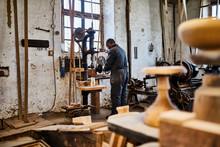 Craftsman Working With Abrasiv...
