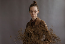 Stylish Lady With Dried Twig