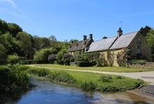 A Typical Cotswold Stone Village House Beside The River Eye In Upper Slaughter, Gloucestershire, England.