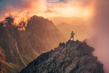 Man In Mountains, Silhouette Of Young Hiker, Sunset Sky And Hills In Background Travel, Adventure Or Expedition Concept..