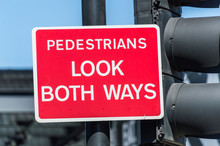 Pedestrians Look Both Ways Warning Board In Red