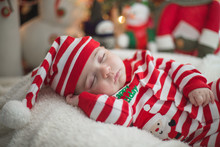 Baby Sleeping By The Tree The Night Before Christmas