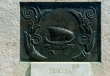 Decorative Plate Relief Of A Ship In Greece. The English Translation Of The Text On The Bottom Is Kerkyra, The Name Of Greek Island