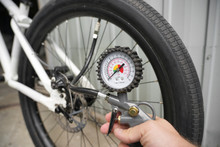 The Pressure Gauge Of The Bicycle Compressor. Shows Air Pressure And Is Connected To The Bike Wheel