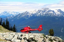 View On The Red Helicopter From Blackcomb Mountain In Whistler, BC.