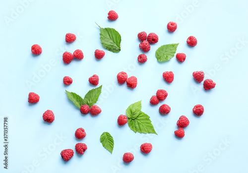 Tasty ripe raspberries on color background Canvas Print