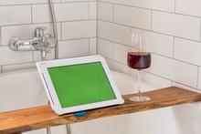 Glass Of Wine On Shelf Near Ta...