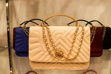 Women's Fashion And Style. Fashionable Female Accessories. Collection Of Women's Handbags On The Shop Window