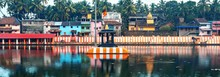 Gokarna, Karnataka, Colorful Indian Houses, Bright Orange-striped Temple Tank On The Bank Of Sacred Lake Koti Teertha. The City Is A Holy Pilgrimage Site For Hinduists