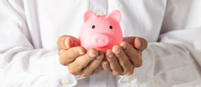 Hand Of Kid Holding Coin Put In Piggy Bank With Money Stack Growing Growth Saving Money, Concept Invesment For Financial Freedom Plan, Business Deposit To Hope Success