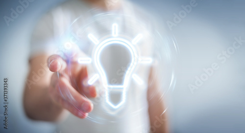 Fotografering Man using lightbulb neon digital interface 3D rendering