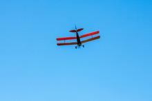 Tiger Moth Plane Flying On The Blue Sky