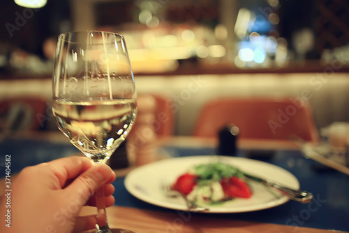 Leinwand Poster glass white wine restaurant interior, abstract evening dinner with alcohol at th