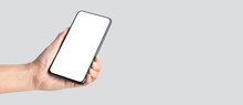Mockup Hand Holding Mobile Blank Screen On Grey Background.mockup Banner Display Of Content To Advert On Media.Clipping Path On Both Hand And Smartphone Screen